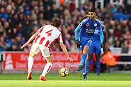 Riyad Mahrez of Leicester City (r) passes the ball past Joe Allen of Stoke City. Premier league match, Stoke City v Leicester City at the Bet365 Stadium in Stoke on Trent, Staffs on Saturday 4th November 2017.<br /> pic by Chris Stading, Andrew Orchard sports photography.