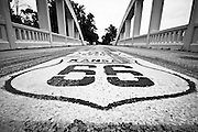 Route 66 sign painted on the pavement of a bridge in Kansas. Missoula Photographer