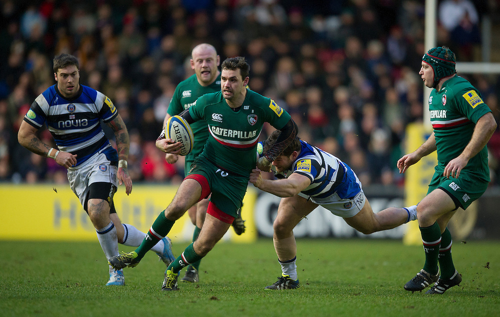 Leicester Tigers' Niall Morris gets away from Bath Rugby's Rob Webber <br /> <br /> Photo by Stephen White/CameraSport<br /> <br /> Rugby Union - Aviva Premiership - Leicester Tigers v Bath Rugby - Sunday 5th January 2014 - Welford Road - Leicester<br /> <br /> © CameraSport - 43 Linden Ave. Countesthorpe. Leicester. England. LE8 5PG - Tel: +44 (0) 116 277 4147 - admin@camerasport.com - www.camerasport.com