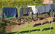Woollen jumpers drying on a washing line in the sun, UK