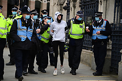 © Licensed to London News Pictures. 03/04/2021. London, UK. Police detain a Protester in Parliament Sqsure during a Kill The Bill demonstration in central London. A number of campaign groups, including Sisters Uncut and Extinction Rebellion, have come together to form a 'Kill the Bill Coalition', which opposes the introduction of the Police, Crime, Sentencing and Courts Bill. Photo credit: Ben Cawthra/LNP