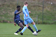 Leeds United midfielder Nohan Kenneh tackles during the U18 Professional Development League match between Coventry City and Leeds United at Alan Higgins Centre, Coventry, United Kingdom on 13 April 2019.