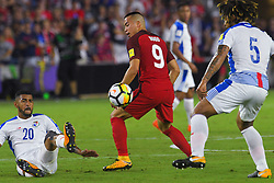 October 6, 2017 - Orlando, Florida, USA - United States forward Bobby Wood (9) brings the ball between Panama defender Roman Torres (5) and midfielder Anibal Godoy (20) during a World Cup qualifying game at Orlando City Stadium on Oct. 6, 2017 in Orlando, Florida.  The US won 4-0....Zuma Press/Scott Miller (Credit Image: © Scott A. Miller via ZUMA Wire)
