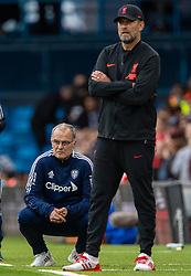 LEEDS, ENGLAND - Sunday, September 12, 2021: Leeds United's manager Marcelo Bielsa (L) and Liverpool's manager Jürgen Klopp during the FA Premier League match between Leeds United FC and Liverpool FC at Elland Road. Liverpool won 3-0. (Pic by David Rawcliffe/Propaganda)