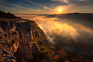 Clouds above a river gorge at autumn time before sunrise