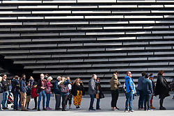 Queue of visitors to the new V&A Museum on first weekend after opening in Dundee , Scotland, UK.