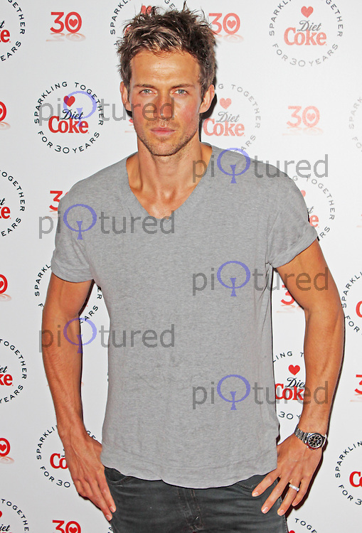 LONDON - January 30: Andrew Cooper at the Diet Coke 30 Years Private Party (Photo by Brett D. Cove)