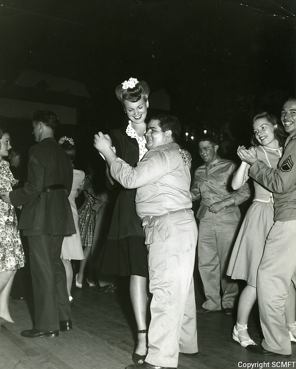 """1943 Six foot tall Bunny Waters Green dances with 5'3"""" Henry Pilla at the Hollywood Canteen"""