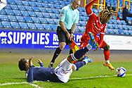 Millwall defender Mahlon Romeo (12)  Nottingham Forest Midfielder Alex Mighten (17) battles for possession during the EFL Sky Bet Championship match between Millwall and Nottingham Forest at The Den, London, England on 19 December 2020.