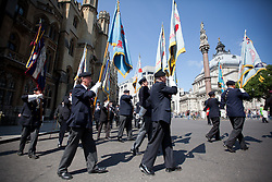 © Licensed to London News Pictures. 11/07/2013. London, UK. British veterans of the Korean War are seen marching to a service held at Westminster Abbey in London today (11/07/2013). The parade and service held to commemorate the 60th Anniversary of the end of the Korean War, often known as the 'Forgotten War', which saw a United Nations force of many nations fight against North Korean and Chinese forces trying to invade South Korea. Photo credit: Matt Cetti-Roberts/LNP