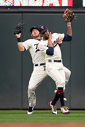 August 17, 2017 - Minneapolis, MN, USA - Minnesota Twins center fielder Byron Buxton, right, and right fielder Robbie Grossman collide as they chased down a fly ball, caught by Buxton, hit by the Cleveland Indians' Carlos Santana in the second inning during the second game of a doubleheader on Thursday, Aug. 17, 2017, at Target Field in Minneapolis. (Credit Image: © Aaron Lavinsky/TNS via ZUMA Wire)