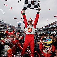 10-12 November, 2006, Autodromos Hermanos Rodriguez, Mexico City, Mexico.<br /> Sebastien Bourdais waves the checkered flag signifying his victory in Mexico City.<br /> © 2006 Phillip Abbott/USA<br /> LAT Photographic