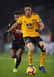 Wolverhampton Wanderers' Raul Jimenez (right) and Bournemouth's Junior Stanislas battle for the ball