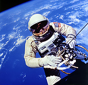 US Astronaut Edward H White II carrying out external tasks during third orbit of Gemini-Titan 4 flight.  NASA photograph.