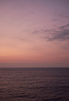 Pastel colored sky and clouds over the Pacific Ocean at dawn.  Image 13 of 21  for a panorama taken with a Fuji X-T1 camera and 35 mm f/1.4 lens  (ISO 400, 35 mm, f/2.8, 1/30 sec). Raw images processed with Capture One Pro and stitched together with AutoPano Giga Pro.