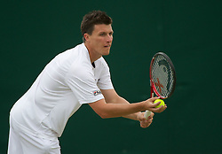 24.06.2011, Wimbledon, London, GBR, Wimbledon Tennis Championships, im Bild Kenneth Skupski (GBR) in action during the Mixed Doubles 1st Round match on day five of the Wimbledon Lawn Tennis Championships at the All England Lawn Tennis and Croquet Club, EXPA Pictures © 2011, PhotoCredit: EXPA/ Propaganda/ *** ATTENTION *** UK OUT!