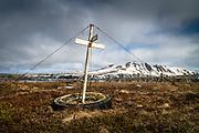 Husavik, Iceland, 5 apr 2019, Cross on an installation for dry fish