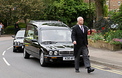 © licensed to London News Pictures. 18/05/2011.Tonbridge, UK. The funeral cortege of heavyweight boxing legend Sir Henry Cooper arriving at Corpus Christi Church in Lyons Crescent, Tonbridge, Kent today (18/05/2011).  Please see special instructions for usage rates. Photo credit should read Ben Cawthra/LNP