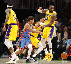 February 12, 2019 - Atlanta, GA, USA - Atlanta Hawks guard Trae Young passes around Los Angeles Lakers forward LeBron James during the second half on Tuesday, Feb. 12, 2019 in Atlanta, Ga. (Credit Image: © Curtis Compton/Atlanta Journal-Constitution/TNS via ZUMA Wire)