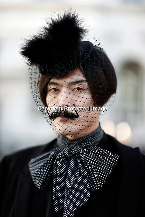 Japanese fashion journalist Yu Masui poses for photographs at Somerset House during London Fashion Week Fall/Winter 2013 in London, Britain, 15 February 2013. The fashion week runs from 15 to 19 February.  EPA/KERIM OKTEN