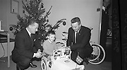 "Presentations at Shell and BP, Fleet Street..1964..18.12.1964..12.18.1964..18th December 1964..At Shell & BP house in Fleet Street, Dublin, the Minister for Justice, Mr Brian Lenihan TD was on hand to present prizes to young winners in ""The Pink Paraffin""competition...Two Shell and BP officials are pictured after this young man was presented with his prize of a pedal car at Shell & BP House, Fleet Street, Dublin."
