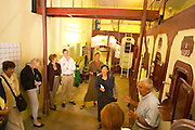 A group of visitors in the winery - concrete storage and fermentation tanks - Chateau La Grave Figeac, Saint Emilion, Bordeaux