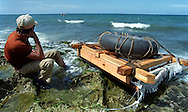 8/1994-Al Diaz/Miami Herald--Sitting by his raft , a man contemplates his departure from the rocky shore of Cojimar, Cuba, as he watches another raft floating in the distance. In 1994 Cuban balseros turned the tiny fishing village into a major point of embarkation for thousands seeking a better life.