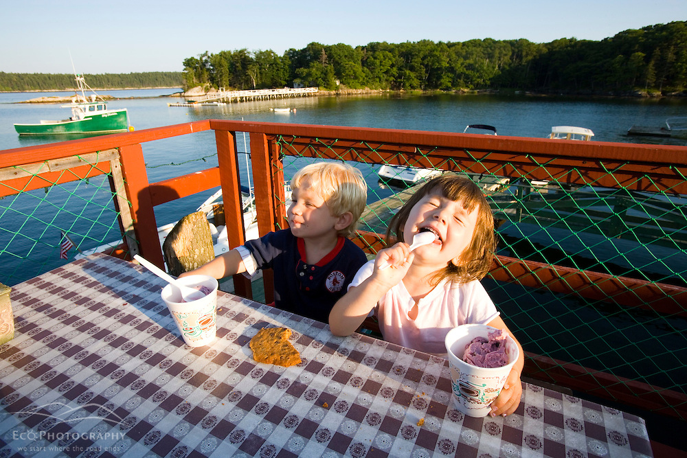 A brother and sister enjoy dessert at Holbrooks Wharf and Lobster Grille in Cundy's Harbor, Maine.
