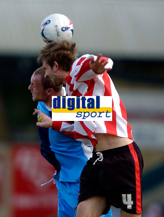 Photo: Richard Lane.<br />Wycombe Wanderers v Lincoln City. Coca Cola League 2. 17/04/2006. <br />Lincoln's Gareth McAuley is challenged by Wycombe's Charlie Griffin.