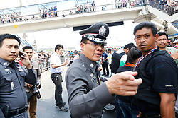 © Licensed to London News Pictures. 19/01/2014. A police chief makes a gesture at the scene of the grenade attack .The grenade attack has reportedly injured 28 people at the protest site at the Victory Monument in Bangkok Thailand. Anti-government protesters launch 'Bangkok Shutdown', blocking major intersections in the heart of the capital, as part of their bid to oust the government of Prime Minister Yingluck Shinawatra ahead of elections scheduled to take place on February 2. Photo credit : Asanka Brendon Ratnayake/LNP