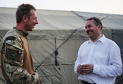 © London News Pictures. 17/06/11.  Dr Liam Fox (R). The Secretary of State for Defence, Dr Liam Fox visited Afghanistan to meet men and women of 3 Commando Brigade in Helmand Province today (15 Jun 11).  Dr Fox began his visit at Task Force Helmand in Lashkar Gah where he was met by the current Brigade commander, Brigadier Ed Davies. .Accompanied by the Chief of the General Staff, General Sir Peter Wall and the first Sealord Admiral Sir Mark Stanhope, the SoS travelled to a number of patrol bases within the province. Photo credit to read Alison Baskerville/LNP