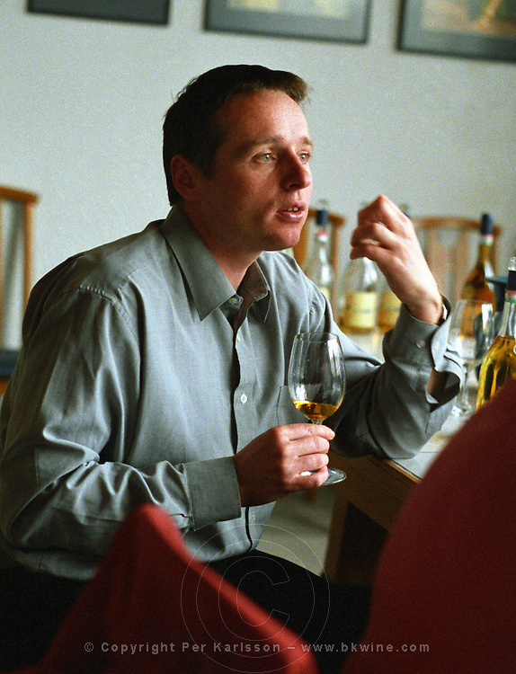 The Disznoko winery in Tokaj: in the tasting room, Mr Laszlo Meszaros, the director of Disznoko and winemaker tasting a glass of Tokaj. The Disznók? winery is owned by AXA Millesimes, a French insurance company. Disznoko means pig's head since a big rock in the vineyard supposedly looks like that. The new winery is impressive and a vast amount of money has been invested. Credit Per Karlsson BKWine.com