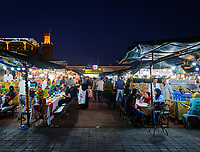 MARRAKESH, MOROCCO - CIRCA APRIL 2018: View of food stalls at the square Jemaa el-Fnaa, at night in Marrakesh