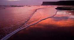 © Licensed to London News Pictures. 25/03/2014<br /> <br /> Saltburn, Cleveland, United Kingdom<br /> <br /> Morning light is reflected on wet sand and on the incoming tide on the beach in Saltburn by the Sea, Cleveland.<br /> <br /> Photo credit : Ian Forsyth/LNP