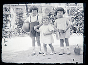 three little children playing in a sandpit France 1924