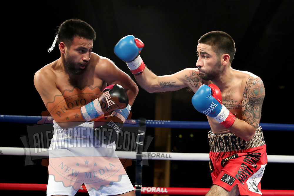 Ramon Cardenas (L) fights Angel Contreras during a One For All Promotions boxing event at the Caribe Royale Orlando Events Center on Saturday, February 20, 2021 in Orlando, Florida. (Alex Menendez via AP)