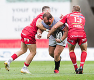 Southern Kings' Schalk Ferreira is tackled by Scarlets' Hadleigh Parkes and Gareth Davies (l). <br /> Guinness Pro14 rugby match, Scarlets v Southern Kings at the Parc y Scarlets in Llanelli, Carms, Wales on Saturday 2nd September 2017.<br /> pic by Craig Thomas, Andrew Orchard sports photography.