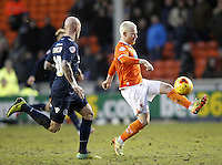 Blackpool's David Perkins in action with Millwall's Richard Chaplow<br /> <br /> Photographer Mick Walker/CameraSport<br /> <br /> Football - The Football League Sky Bet Championship - Blackpool v Millwall - Saturday 10th January 2015 - Bloomfield Road - Blackpool <br /> <br /> © CameraSport - 43 Linden Ave. Countesthorpe. Leicester. England. LE8 5PG - Tel: +44 (0) 116 277 4147 - admin@camerasport.com - www.camerasport.com