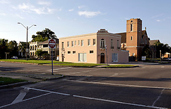 23 August 2015. New Orleans, Louisiana. <br /> Hurricane Katrina revisited. <br /> Gloria Dei Lutheran Church where Napoleon Ave meets South Broad Street and Fontainbleau Drive almost a decade after the storm.<br /> Photo credit©; Charlie Varley/varleypix.com.