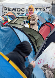 © Licensed to London News Pictures. 13/02/2012. London, UK. A protestor outside his tent at the Occupy London camp at St Paul's Cathedral on February 13th, 2012 in London, England. An appeal is being heard at the High Court today (13/02/2012) against a judgement handed down for the group's eviction from the protest camp brought by the City of London Corporation. Photo credit : Ben Cawthra/LNP