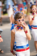 A young member of Uncle Sam's Band with their kazoo's during the annual I'On Community Independence Day Parade on July 4, 2012 in Mt Pleasant, South Carolina.