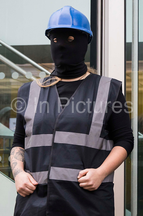 An activist dressed as a HS2 enforcement agent takes part in a HS2 Chainsaw Massacre protest outside the Among The Trees exhibition at the Hayward Gallery on 30 October 2020 in London, United Kingdom. The protest was intended to highlight both the daily environmental destruction being wrought for the controversial HS2 high-speed rail project and instances of violence and brutality by security guards and bailiffs working on behalf of HS2 Ltd.