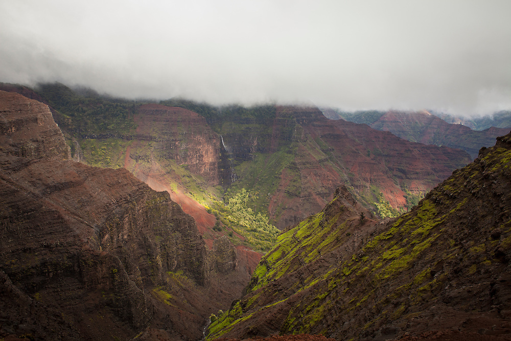 """Waimea Canyon, on Kauai's West Side, is described as """"The Grand Canyon of the Pacific."""" It's 14 miles long, one mile wide and more than 3,600 feet deep."""