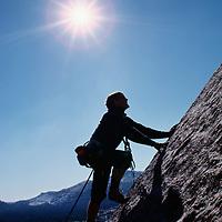 Yosemite National Park, California. Rock climber on Polly Dome above Lake Tenaya near Tuolumne Meadows.  Jay Jensen (MR)