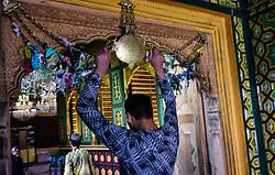 May 27, 2019 - Srinagar, India - Kashmiri Muslims offer prayers at a shrine on the anniversary of Martyrdom of Imam Ali in Srinagar, Indian Administered Kashmir on 27 May 2019. (Credit Image: © Muzamil Mattoo/NurPhoto via ZUMA Press)