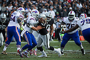 Oakland Raiders defensive end James Cowser (47) sacks Buffalo Bills quarterback Tyrod Taylor (5) at Oakland Coliseum in Oakland, Calif., on December 4, 2016. (Stan Olszewski/Special to S.F. Examiner)