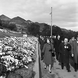29/10/1966. Queen Elizabeth II and the Duke of Edinburgh view flowers during a visit to the village of Aberfan, South Wales, where a coal-tip avalanche killed 144 victims.