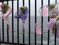 Floral tributes to young woman who died after falling over cliff at Whitley Bay; Tyneside UK 2006