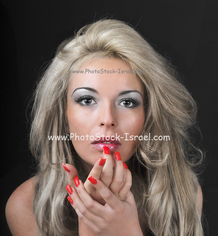 portrait of a Glamourous woman with red nail polish