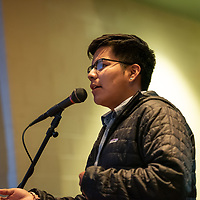 """Navajo Preparatory School senior Logan Reano, 17, asks the first question of the Q&A portion of the forum. The """"Education is our Human Right"""" forum was held at the Phil L. Thomas Performing Arts Center in Shiprock on Thursday."""